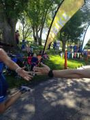Triathlete version of the Sistine Chapel, high fiving a teammate before I cross the finish line.